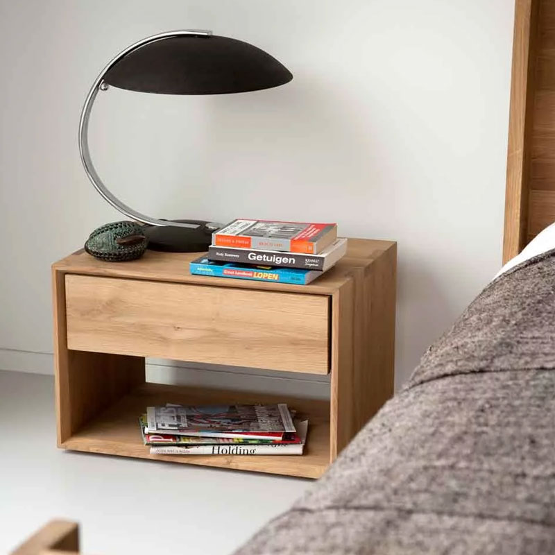 Ethnicraft Nordic Bedside Table by Alain van Havre Lifeshot 01 Olson and Baker - Designer & Contemporary Sofas, Furniture - Olson and Baker showcases original designs from authentic, designer brands. Buy contemporary furniture, lighting, storage, sofas & chairs at Olson + Baker.
