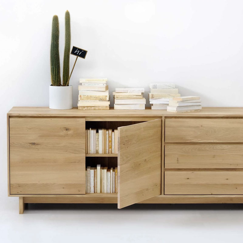 Ethnicraft Wave Sideboard by Constance Guisset Oak Lifeshot 01 Olson and Baker - Designer & Contemporary Sofas, Furniture - Olson and Baker showcases original designs from authentic, designer brands. Buy contemporary furniture, lighting, storage, sofas & chairs at Olson + Baker.