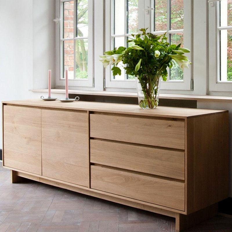 Ethnicraft Wave Sideboard by Constance Guisset Oak Lifeshot 02 Olson and Baker - Designer & Contemporary Sofas, Furniture - Olson and Baker showcases original designs from authentic, designer brands. Buy contemporary furniture, lighting, storage, sofas & chairs at Olson + Baker.
