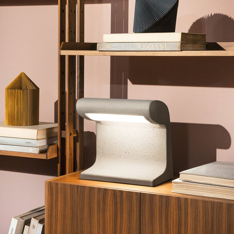 Nemo Borne Beton Petite Table Lamp by Le Corbusier life 1 Olson and Baker - Designer & Contemporary Sofas, Furniture - Olson and Baker showcases original designs from authentic, designer brands. Buy contemporary furniture, lighting, storage, sofas & chairs at Olson + Baker.