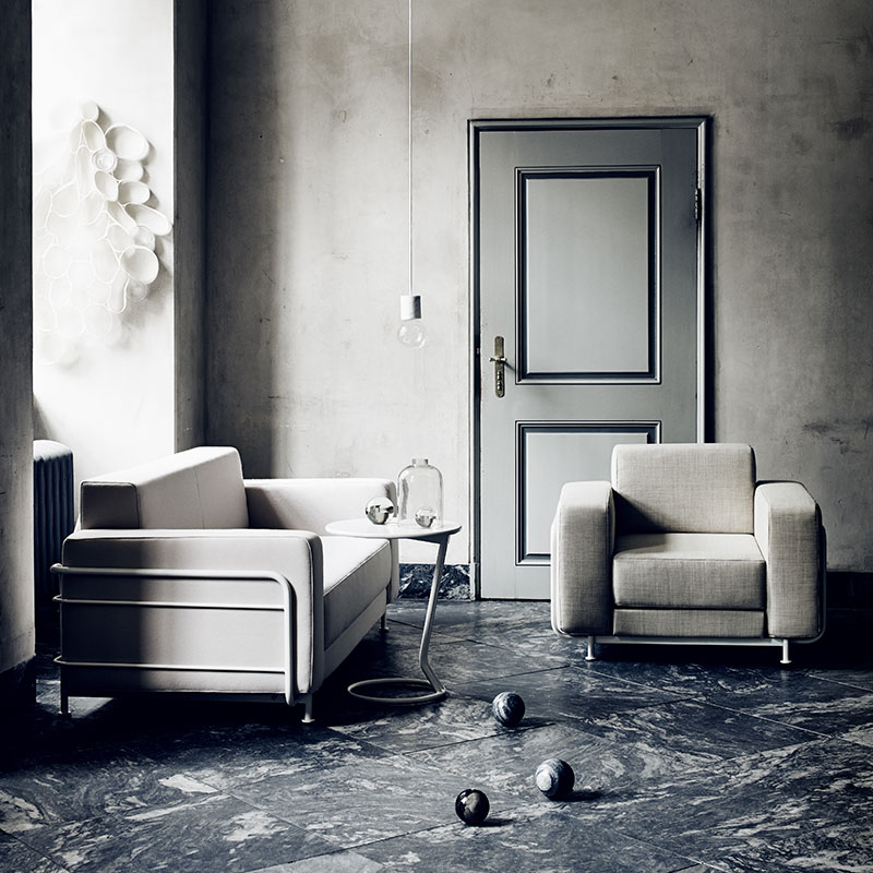 Softline Silver Chair Lifeshot 01 Olson and Baker - Designer & Contemporary Sofas, Furniture - Olson and Baker showcases original designs from authentic, designer brands. Buy contemporary furniture, lighting, storage, sofas & chairs at Olson + Baker.