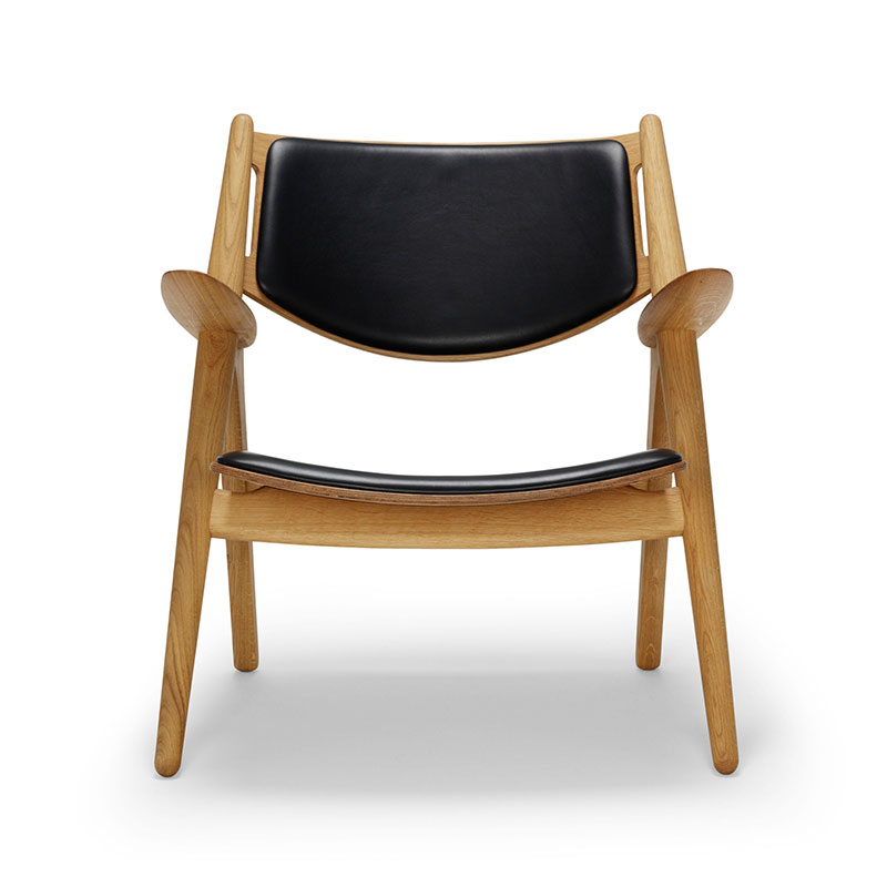 Carl Hansen CH28P Upholstered Lounge Chair by Hans Wegner Olson and Baker - Designer & Contemporary Sofas, Furniture - Olson and Baker showcases original designs from authentic, designer brands. Buy contemporary furniture, lighting, storage, sofas & chairs at Olson + Baker.