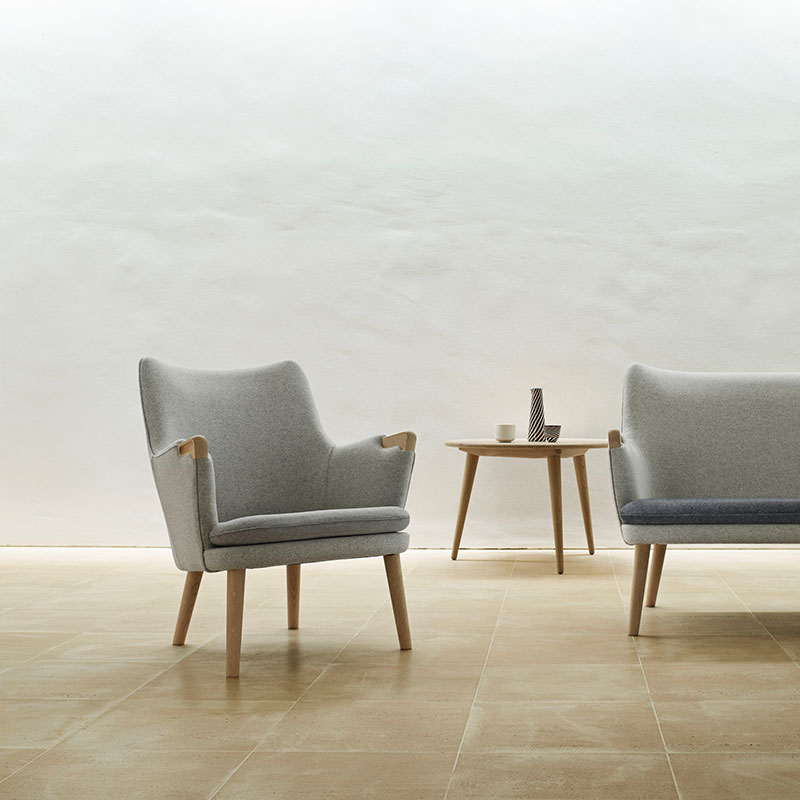 Carl Hansen CH71 Lounge Chair by Hans Wegner life 2 Olson and Baker - Designer & Contemporary Sofas, Furniture - Olson and Baker showcases original designs from authentic, designer brands. Buy contemporary furniture, lighting, storage, sofas & chairs at Olson + Baker.