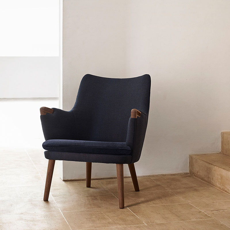 Carl Hansen CH71 Lounge Chair by Hans Wegner life 3) Olson and Baker - Designer & Contemporary Sofas, Furniture - Olson and Baker showcases original designs from authentic, designer brands. Buy contemporary furniture, lighting, storage, sofas & chairs at Olson + Baker.