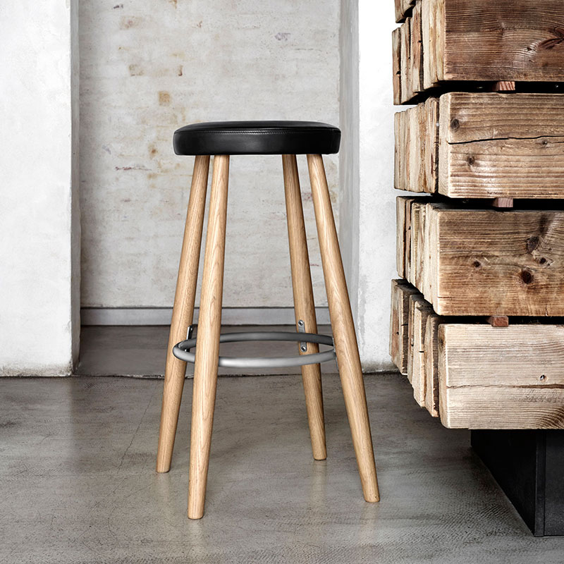 Carl Hansnen CH56 Bar Stool life 1 Olson and Baker - Designer & Contemporary Sofas, Furniture - Olson and Baker showcases original designs from authentic, designer brands. Buy contemporary furniture, lighting, storage, sofas & chairs at Olson + Baker.