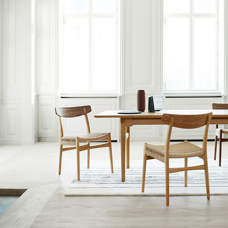 Carl Hansen CH23 Chair by Hans Wegner life 1 Olson and Baker - Designer & Contemporary Sofas, Furniture - Olson and Baker showcases original designs from authentic, designer brands. Buy contemporary furniture, lighting, storage, sofas & chairs at Olson + Baker.