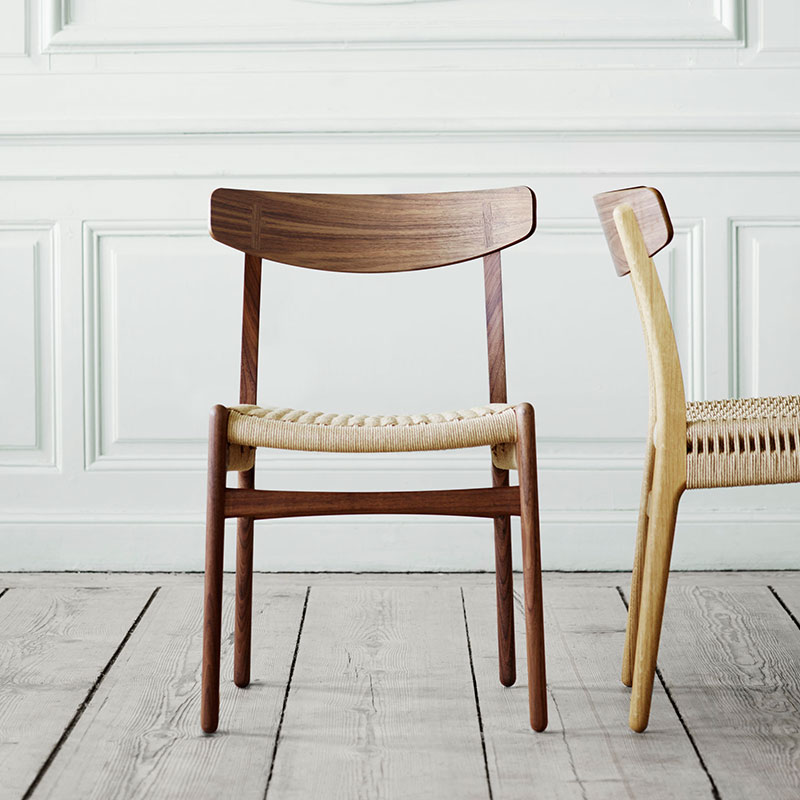 Carl Hansen CH23 Chair by Hans Wegner life 4 Olson and Baker - Designer & Contemporary Sofas, Furniture - Olson and Baker showcases original designs from authentic, designer brands. Buy contemporary furniture, lighting, storage, sofas & chairs at Olson + Baker.