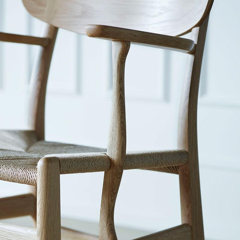 Carl Hansen CH26 Dining Chair by Hans Wegner life 2 Olson and Baker - Designer & Contemporary Sofas, Furniture - Olson and Baker showcases original designs from authentic, designer brands. Buy contemporary furniture, lighting, storage, sofas & chairs at Olson + Baker.