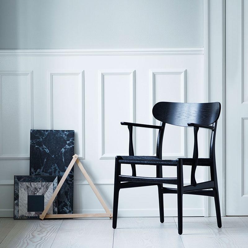 Carl Hansen CH26 Dining Chair by Hans Wegner life 5 Olson and Baker - Designer & Contemporary Sofas, Furniture - Olson and Baker showcases original designs from authentic, designer brands. Buy contemporary furniture, lighting, storage, sofas & chairs at Olson + Baker.