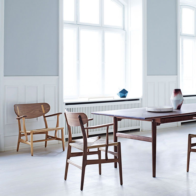 Carl Hansen CH327 Dining Table by Hans Wegner in Walnut life 1 Olson and Baker - Designer & Contemporary Sofas, Furniture - Olson and Baker showcases original designs from authentic, designer brands. Buy contemporary furniture, lighting, storage, sofas & chairs at Olson + Baker.