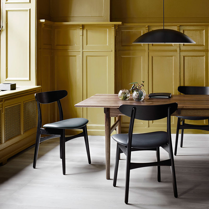 Carl Hansen CH327 Dining Table by Hans Wegner in Walnut life 2 Olson and Baker - Designer & Contemporary Sofas, Furniture - Olson and Baker showcases original designs from authentic, designer brands. Buy contemporary furniture, lighting, storage, sofas & chairs at Olson + Baker.