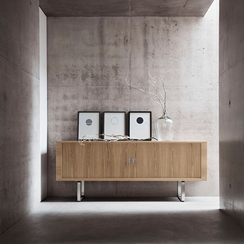Carl Hansen CH825 Credenza by Hans Wegner life 1 Olson and Baker - Designer & Contemporary Sofas, Furniture - Olson and Baker showcases original designs from authentic, designer brands. Buy contemporary furniture, lighting, storage, sofas & chairs at Olson + Baker.