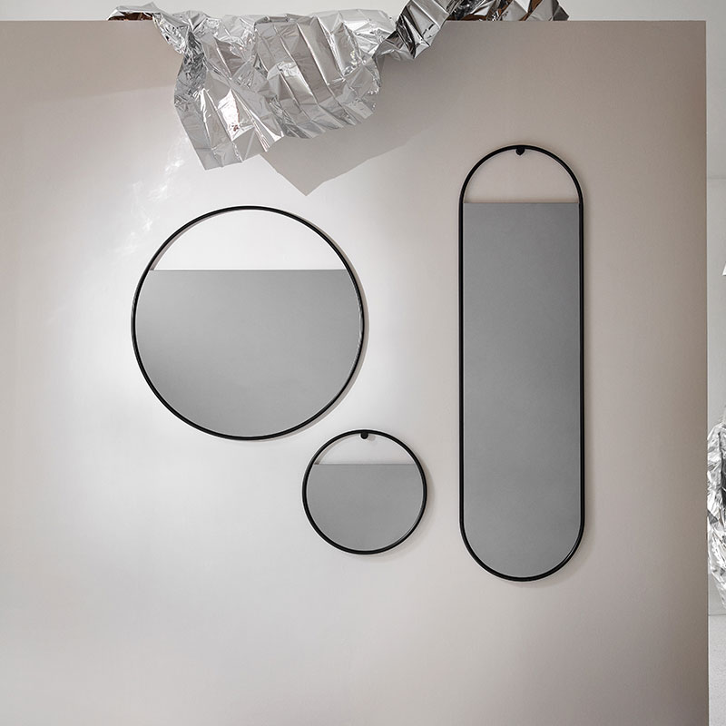 Northern_Peek_Oval_Wall_Mirror_Large_by_Elina Ulvio_Lifeshot_02 Olson and Baker - Designer & Contemporary Sofas, Furniture - Olson and Baker showcases original designs from authentic, designer brands. Buy contemporary furniture, lighting, storage, sofas & chairs at Olson + Baker.